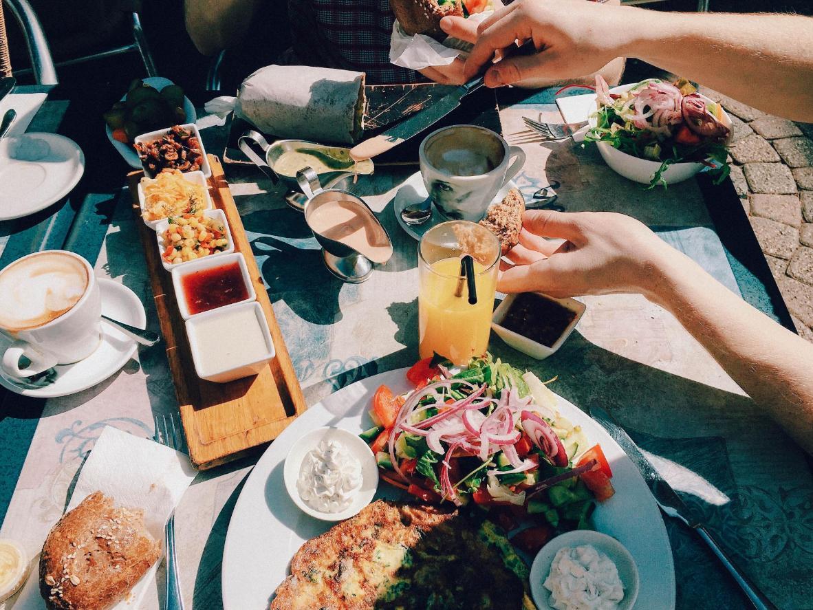 Enjoy a typical Tel Aviv sharing platter al fresco in spring