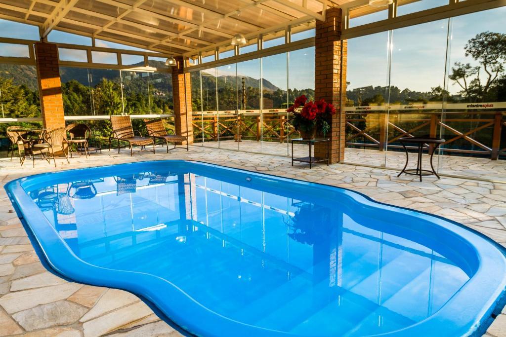 สระว่ายน้ำที่อยู่ใกล้ ๆ หรือใน Pousada Suíça Mineira