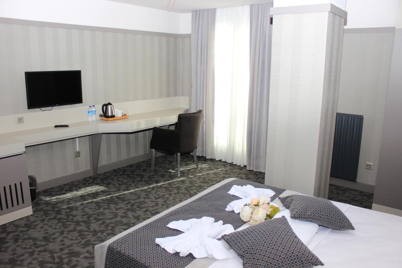 Letto o letti in una camera di Anka Premium Hotel