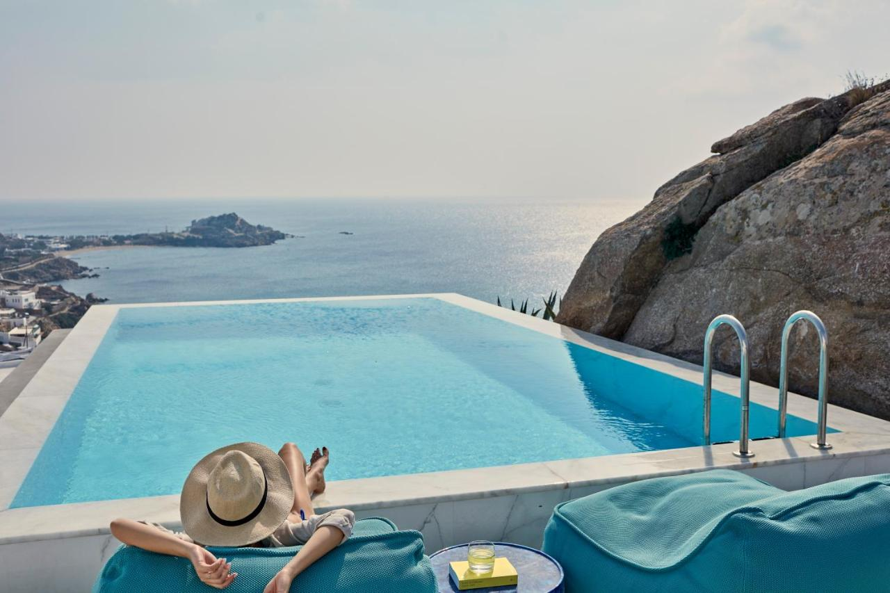 Mykonian Ambassador hotel - relaxing at the pool, with a view of the sea