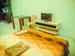 โทรทัศน์และ/หรือระบบความบันเทิงของ Club Royal Wongamat Apartment Unit 611