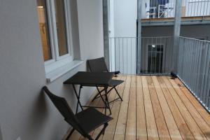 ระเบียงหรือลานระเบียงของ Moderne Stadtwohnung mit Balkon