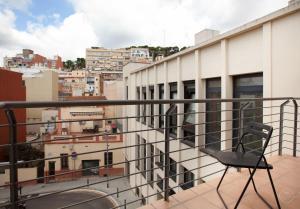 ระเบียงหรือลานระเบียงของ Guell Modern Apartment