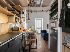 ครัวหรือมุมครัวของ Over The Tiber Loft